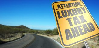 Luxury tax ahead road sign stock photos