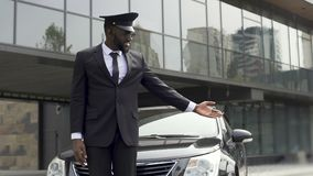 Luxury taxi service driver welcoming very important client near expensive car. Stock footage stock video footage