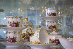 Luxury tea set with painted roses Stock Images