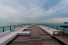 Luxury terace on beach. Luxury terace over the sea, with stormy sky royalty free stock images