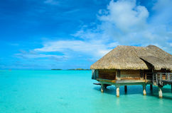 Luxury thatched roof honeymoon bungalow royalty free stock photography