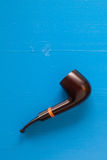 Luxury tobacco pipe on the blue table Stock Images