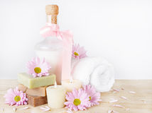 Luxury Toiletries with Flowers and Candles Royalty Free Stock Photo