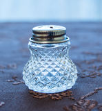 Luxury transparent saltshaker. With pretty decorations on a decorated cover royalty free stock images
