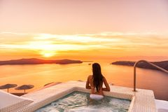 Free Luxury Travel Santorini Vacation Woman Swimming In Hotel Jacuzzi Pool Watching Sunset. Europe Resort Destination Holiday For Royalty Free Stock Image - 155625416