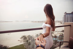 Luxury travel vacation woman holding hand of husband following h. Luxury travel vacation women holding hand of husband following her, view from behind. Woman royalty free stock photo