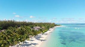 Luxury tropical beach in Mauritius. Beach with palms and blue ocean. Aerial view