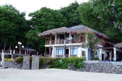 luxury tropical beach resort cute bungalows standing on white sand beach Stock Image