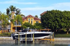 Luxury tropical home and boats Stock Photos