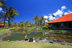 Luxury tropical hotel cottage. With pond Royalty Free Stock Image