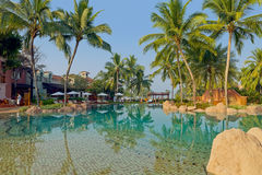Luxury tropical resort. Luxury tropical holiday resort with swimming pool, vacation concept. Goa, India Royalty Free Stock Image