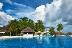 Luxury tropical swimming pool. Luxury swimming pool in the tropical hotel Royalty Free Stock Photos