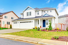 Luxury two level house exterior with garage and concrete driveway. Royalty Free Stock Photography