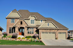 Luxury Two Story Suburban Executive Home. Real estate, copy space Royalty Free Stock Photo