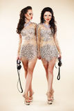 Luxury. Two Trendy Women Walking in Shiny Bright Dresses Stock Photo