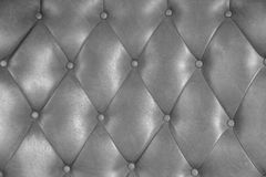 Luxury upholstery leather button chair texture. In grey Royalty Free Stock Image