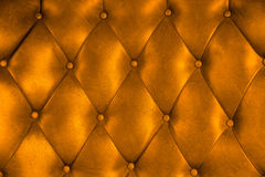 Luxury upholstery leather button chair texture. In orange Stock Photo