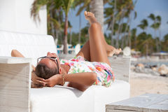 Luxury vacation beautiful woman relaxing Royalty Free Stock Photos
