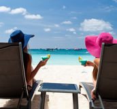 Luxury vacation for woman. White tropical beach. Royalty Free Stock Photo