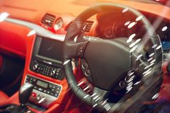 Luxury vehicle interior car dashboard with steering wheel. Made from leather Royalty Free Stock Photography
