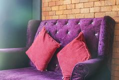 Luxury velvet violet sofa with red cushion for seat. Close up luxury velvet violet sofa with red cushion for seat stock image