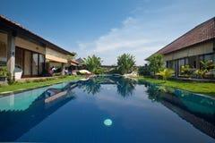 Luxury villa. With garden surrounding beautiful pool in the tropics royalty free stock photo