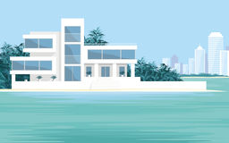 The luxury Villa. Abstract image of a large, beautiful country house on a background of a modern metropolis. Luxury Villa on the seafront, surrounded by palm Stock Images