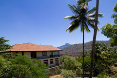 Luxury villa amidst nature. A villa in the midst of natural tropical settings royalty free stock photo