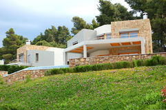 The luxury villa and green lawn. Halkidiki, Greece royalty free stock image