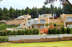 The luxury villa and green lawn. Halkidiki, Greece royalty free stock photo