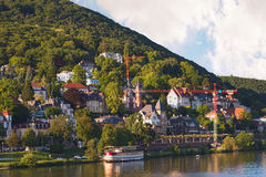 Luxury villa by the hill river side. In Europe and construction crane royalty free stock image