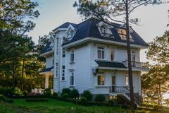 Luxury villa with many pine trees stock photography