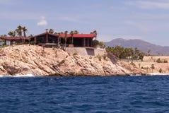 Luxury villa overlooking the sea. Beachfront Luxury villa embedded in the rocks Royalty Free Stock Image
