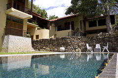 Luxury Villa with a pool. Exterior view of a luxury villa from the poolside royalty free stock photography