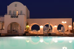 Luxury villa with private pool at night, Oia, Santorini Stock Photos