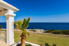 Luxury villa with sea view. Detail view of terrace from a luxury house with palm tree and sea view royalty free stock photo