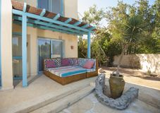 Patio area with sofa and table at a luxury tropical holiday villa resort. Luxury villa show home in tropical summer holiday resort with patio area showing sofa stock photos