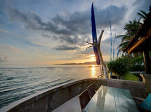 Luxury villa on sunset. Sunset over Balinese coastline. View from luxury hotel stock photography