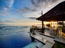 Luxury villa on sunset. Sunset over Balinese coastline. View from luxury hotel Royalty Free Stock Photos
