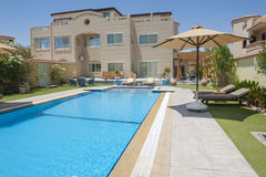 Luxury villa with a swimming pool Stock Images
