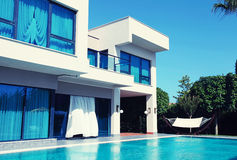 Luxury villa with swimming pool in a summer resort. Toned image royalty free stock photo