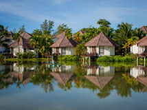 Luxury villa in tropical surroundings by the water Stock Photography