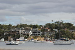 Luxury villas and sailing boats royalty free stock image