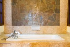 Luxury vintage bathroom. Close up of bathtub in a luxury vintage bathroom Stock Images