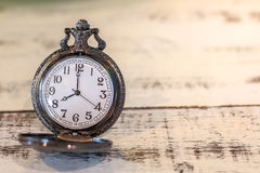 Luxury vintage black pocket watch on wood table, abstract for time concept with copy space Royalty Free Stock Image