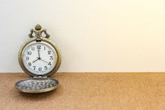 Luxury vintage black pocket watch on wood table, abstract for time concept with copy space Stock Photos