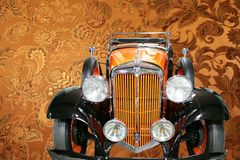 Luxury vintage car. Vintage car on the luxury decorated background Royalty Free Stock Image