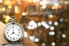 Luxury vintage golden pocket watch on wood over blurred light bokeh background with warm light,abstract background,  time concept Stock Photo