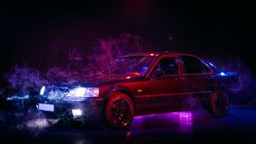 Luxury vintage japan car with red and blue lighting and fog stock photography