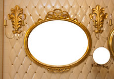Luxury vintage mirror isolated inside. Luxury vintage mirror with gold frame on the wall. Isolated inside stock photo